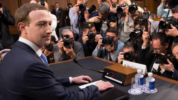 Facebook founder and CEO Mark Zuckerberg arrives to testify during a Senate Commerce, Science and Transportation Committee and Senate Judiciary Committee joint hearing about Facebook on Capitol Hill in Washington, DC, April 10, 2018. / AFP PHOTO / SAUL LOEB        (Photo credit should read SAUL LOEB/AFP/Getty Images)