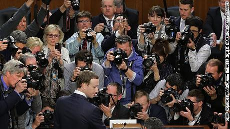 WASHINGTON, DC - APRIL 10:  Facebook co-founder, Chairman and CEO Mark Zuckerberg arrives to testify before a combined Senate Judiciary and Commerce committee hearing in the Hart Senate Office Building on Capitol Hill April 10, 2018 in Washington, DC. Zuckerberg, 33, was called to testify after it was reported that 87 million Facebook users had their personal information harvested by Cambridge Analytica, a British political consulting firm linked to the Trump campaign.  (Photo by Chip Somodevilla/Getty Images