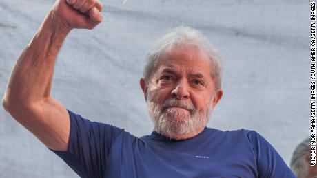 "SAO BERNARDO DO CAMPO, BRAZIL - APRIL 07:  Former President Luiz Inacio Lula da Silva gestures to supporters at the headquarters of the Metalworkers' Union where a Catholic mass was held in memory of his late wife Marisa Leticia on April 7, 2018 in the Sao Bernardo do Campo section of Sao Paulo, Brazil. An arrest warrant was issued on Thursday for da Silva to serve a 12-year jail term for corruption. The 72 year old former president told the crowd ""I will comply with their warrant."" (Photo by Victor Moriyama/Getty Images)"