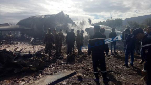 Firefighters and soldiers at the scene of the crash.