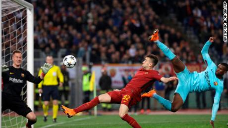 Barcelona goalkeeper Marc-Andre ter Stegen, left, saves as Roma's Stephan El Shaarawi, center, tries to score.