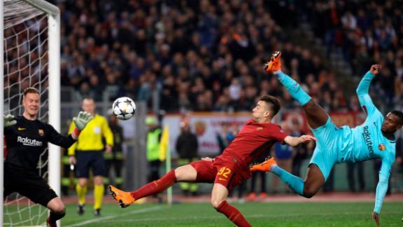 Barcelona goalkeeper Marc-Andre ter Stegen, left, saves as Roma's Stephan El Shaarawi, center, tries to score.