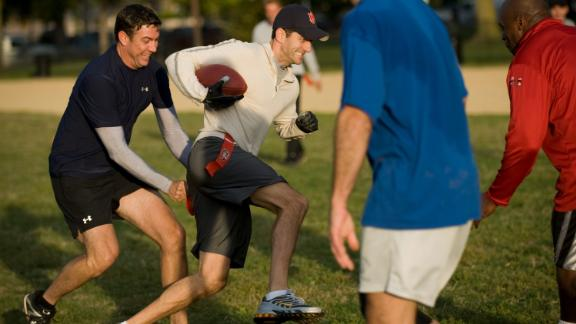 Ryan tries to evade Rep. Duncan Hunter during a flag football practice in 2009 on the National Mall in Washington. Members of Congress soon would square off against members of the Capitol Police.