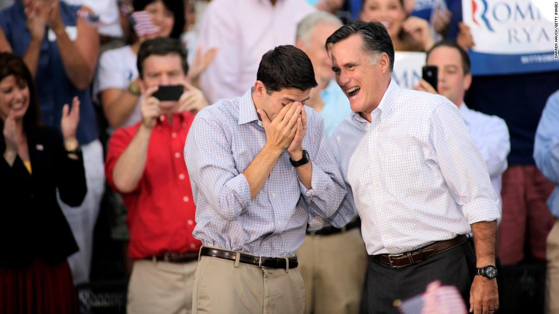 Ryan wipes away tears as he and Romney greet supporters during a 2012 campaign event in Waukesha, Wisconsin.