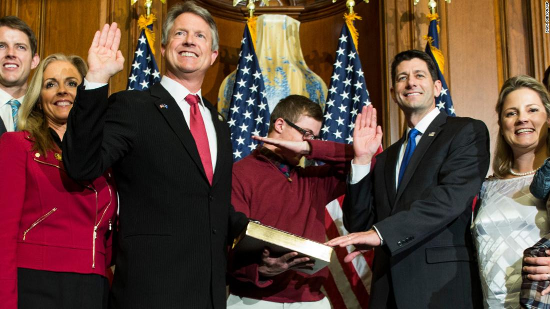 "Ryan administers the oath of office to Rep. Roger Marshall in 2017 as one of Marshall's sons ""dabs"" during an unofficial ceremony."