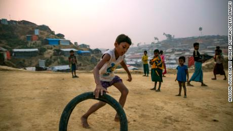 COX'S BAZAR, BANGLADESH - JANUARY 14: Rohingya refugee children play in Balukhali camp on January 14, 2018 in Cox's Bazar, Bangladesh. Over 650,000 Rohingya have crossed the border to Bangladesh since August last year, fleeing the violence at Rakhine State when their villages were attacked and many worry that they will face further reprisals if they return to Myanmar. The refugee camps in Bangladesh no longer seem temporary as thousands of tents made of plastic and bamboo spread across the undulating terrain and long wooden bridges connect parts of the camps divided by water. Existing camps such as Nayapara and Kutupalong have swelled to accommodate the new arrivals since the Myanmar military began its campaign in late August while the Rohingya queue for hours to get rations due to little access to clean water, health care or food and the refugee camps turn into mud-baths whenever it rains. International aid groups and health workers have estimated at least 6,700 Rohingya had met with violent deaths and warn of potential outbreaks of cholera and other preventable diseases due to squalid conditions. (Photo by Allison Joyce/Getty Images)
