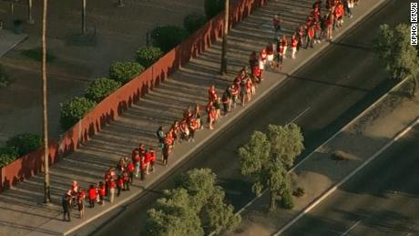 Protesting teachers gather Wednesday before class outside Ironwood High School in Glendale, Arizona.
