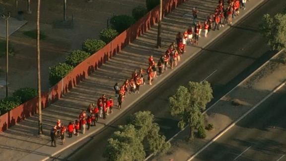Protesting teachers gather Wednesday before class outside Ironwood High School in Glendale, Arizona.
