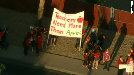 Educators and their supporters gather Wednesday morning outside Glendale's Ironwood High.