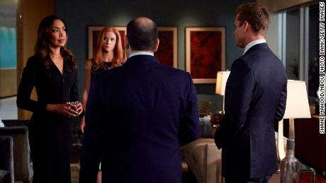 "Gina Torres as Jessica Pearson, Sarah Rafferty as Donna Paulsen, and Gabriel Macht as Harvey Specter in ""Suits."""