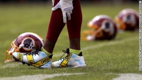 Wide receiver DeSean Jackson #11 of the Washington Redskins wears cleats displaying police caution tape prior to a game against the Cleveland Browns at FedExField on October 2, 2016 in Landover, Maryland.