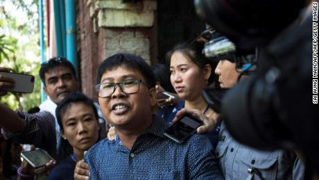 Detained Myanmar journalist Wa Lone (C) is escorted by police to a prison van after another day in his ongoing trial in Yangon on April 11, 2018. A Myanmar court on April 11 rejected a motion to drop a case against two Reuters journalists arrested while investigating a massacre of Rohingya Muslims, pushing ahead with a controversial prosecution that has sparked global outrage. / AFP PHOTO / SAI AUNG MAIN        (Photo credit should read SAI AUNG MAIN/AFP/Getty Images)