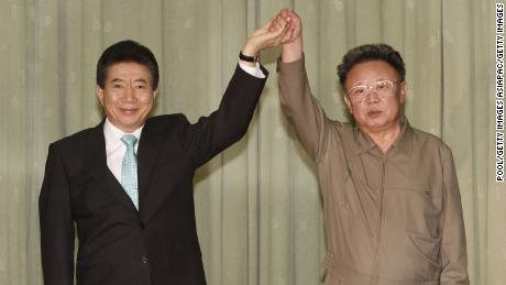 The late North Korean leader Kim Jong Il clasps hands with former South Korean President Roh Moo-hyun after they exchanged a joint statement on October 4, 2007 in Pyongyang, North Korea. Roh died in 2009.