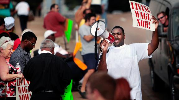 Antonio Cathey leads a crowd of fast food workers in a Fight for $15 protest in Memphis. The campaign has raised wages for low income workers but inspired a fierce counterattack by some lawmakers.