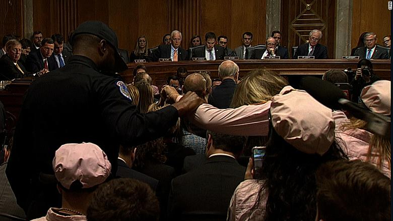 Protester removed from Pompeo hearing