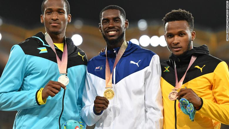 British Virgin Islands Kyron Mcmaster (C gold), Bahamas Jeffery Gibson (L silver) and Jamaicas Jaheel Hyde (bronze) pose with their medals after the athletics men's 400m hurdles final.