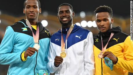 British Virgin Islands Kyron Mcmaster (C gold), Bahamas Jeffery Gibson (L silver) and Jamaicas Jaheel Hyde (bronze) pose with their medals after the athletics men's 400m hurdles final during the 2018 Gold Coast Commonwealth Games at the Carrara Stadium on the Gold Coast on April 12, 2018. / AFP PHOTO / SAEED KHAN        (Photo credit should read SAEED KHAN/AFP/Getty Images)
