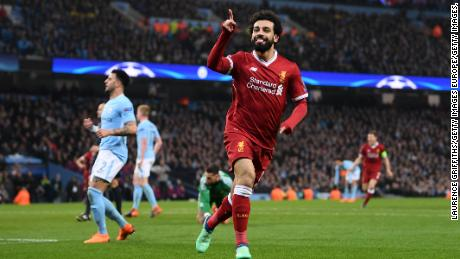 MANCHESTER, ENGLAND - APRIL 10:  Mohamed Salah of Liverpool celebrates after scoring his sides first goal during the UEFA Champions League Quarter Final Second Leg match between Manchester City and Liverpool at Etihad Stadium on April 10, 2018 in Manchester, England.  (Photo by Laurence Griffiths/Getty Images,)