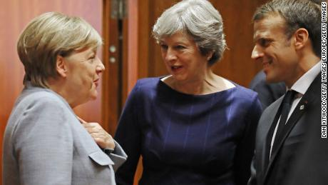 BRUSSELS, BELGIUM - OCTOBER 19:  German Chancellor Angela Merkel, Britain's Prime Minister Theresa May and French President Emmanuel Macron arrive for a round table meeting on October 19, 2017 in Brussels, Belgium. Under discussion are the Iran Nuclear Deal, Brexit and North Korea. Mrs May has offered assurances to EU nationals that her government will make it as easy as possible to remain living in the United Kingdom after Brexit.  (Photo by Dan Kitwood/Getty Images)