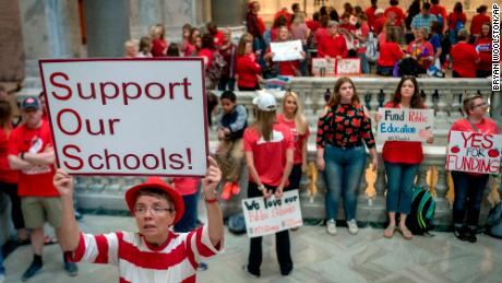 Teacher Karen Schwartz stands outside House chambers Friday as educators gather in Frankfort.