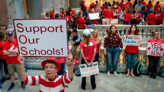 Teacher Karen Schwartz stands outside House chambers Friday as educators gather in Frankfort.