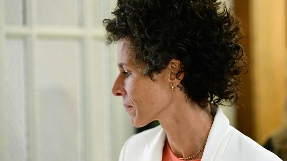 Key witness Andrea Constand walks during a lunch break on Friday, April 13, 2018, during the retrial of Bill Cosby on assault charges in Norristown, Pennsylvania.