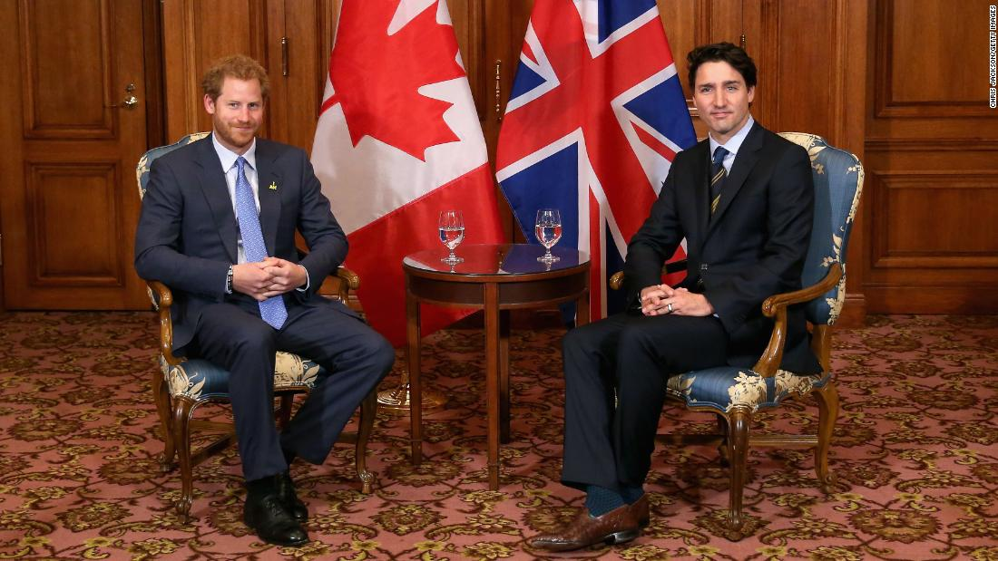 "Harry posed with Canadian Prime Minister Justin Trudeau during a trip to Toronto in 2016. ""Formality and ceremony are very much part of your job as a royal. It's not always relaxed,"" says Jackson. ""(Harry) seems to have a strong bond with Trudeau. It was nice to photograph these two together."" Toronto, Canada, May 2016."