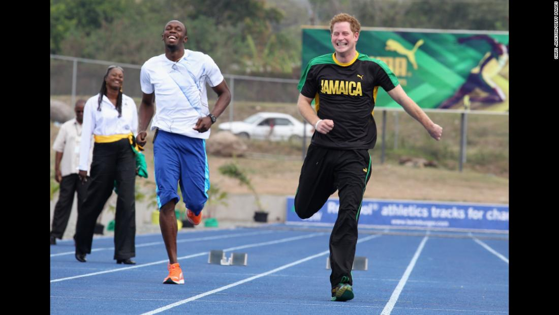 "During a visit to Jamaica, Prince Harry challenged world-class sprinter Usain Bolt to a race. ""I remember it so clearly,"" says Jackson. ""Prince Harry sprinted off leaving Bolt trailing in his wake. That caught me by surprise... That's the kind of thing that happens with Harry. You've got to learn to always be ready."" Kingston, Jamaica, March 2012."