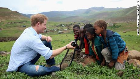 In one of Jackson's favorite pictures he has taken of the prince, Harry shows children in Lesotho a photo he has taken on his own camera. This was during a trip in December 2014.
