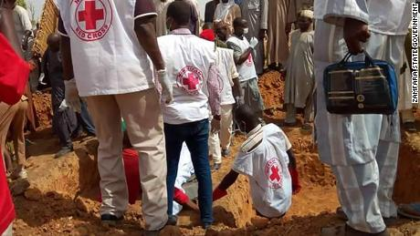 Nigerian Red Cross officials prepare a mass grave in Anka town in Zamfara, Nigeria.