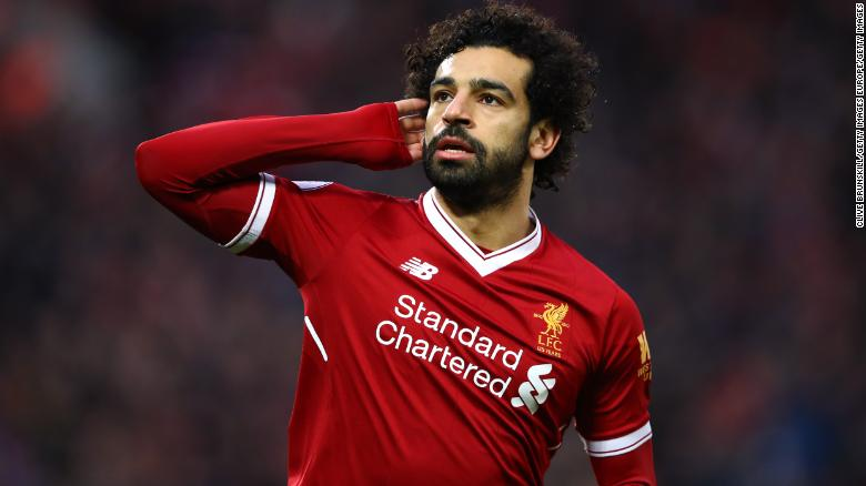 Mohamed Salah Of Liverpool Celebrates After Scoring His Sides First Goal During The Premier League Match