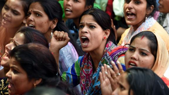 Indian women sit during a protest organized by 'Delhi Commission for Women' in New Delhi on April 13, 2018, outside Raj Ghat, memorial for Indian independence icon Mahatama Gandhi.
