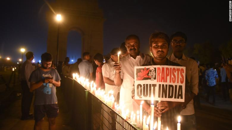 Indian demonstrators gather at the India Gate monument for a late night candlelight vigil in protest over the gang rape and murder of an eight-year-old girl, in New Delhi on April 13, 2018.