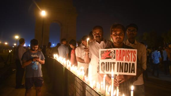 Indian demonstrators gather at the India Gate monument for a late night candlelight vigil on April 13.