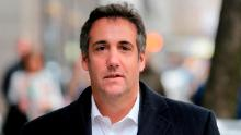 In this Wednesday, April 11, 2018, photo, Michael Cohen, President Donald Trump's personal attorney, walks along a sidewalk in New York. The company that publishes the National Enquirer paid a former doorman at one of Trump's New York skyscrapers $30,000 during the presidential campaign for a tip about Trump it never ran. Dino Sajudin signed a contract with American Media Inc. that barred him from discussing his tip with anyone. Cohen acknowledged to the AP that he had discussed Sajudin's story with the magazine when the tabloid was working on it. He said he was acting as a Trump spokesman when he did so and denied knowing anything beforehand about the Enquirer payment to the ex-doorman. (AP Photo/Seth Wenig)