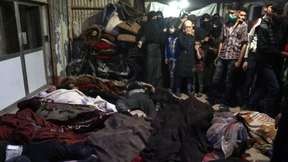 Bodies lie on the ground in the rebel-held city of Douma, Syria, on April 8, 2018. According to activist groups, helicopters dropped barrel bombs filled with toxic gas on Douma, which has been the focus of a renewed government offensive that launched in mid-February. The Syrian government and its key ally, Russia, vehemently denied involvement and accused rebel groups of fabricating the attack to hinder the army