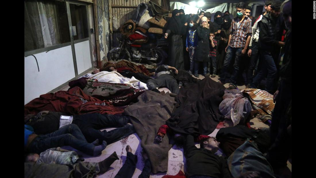 "Bodies lie on the ground in the rebel-held city of Douma, Syria, on April 8, 2018. <a href=""https://www.cnn.com/2018/04/11/middleeast/syria-chemical-attack-500-affected-who-intl/index.html"" target=""_blank"">According to activist groups,</a> helicopters dropped barrel bombs filled with toxic gas on Douma, which has been the focus of a renewed government offensive that launched in mid-February. The Syrian government and its key ally, Russia, vehemently denied involvement and accused rebel groups of fabricating the attack to hinder the army's advances and provoke international military intervention."
