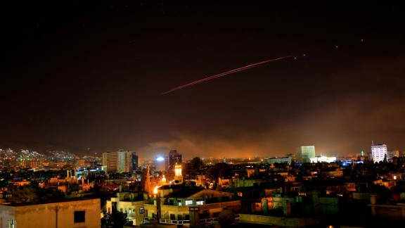 Damascus skies erupt with anti-aircraft fire as the US and its allies launch an attack on Syria