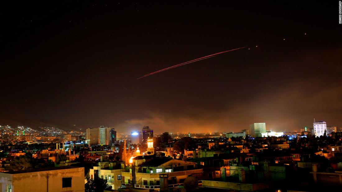 Damascus skies erupt with anti-aircraft fire as the US and its allies launch an attack on Syria's capital early on April 14, 2018. US President Donald Trump announced airstrikes in retaliation for Syria's alleged use of chemical weapons. Trump says the strikes are part of a sustained military response, in coordination with France and the United Kingdom.
