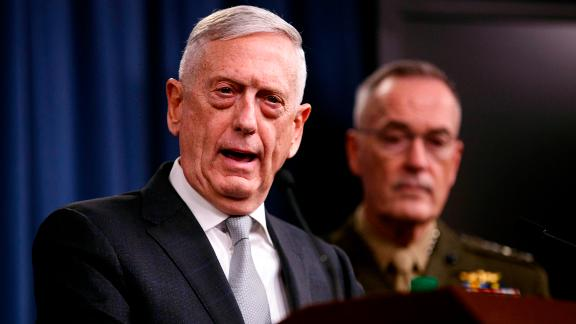 Defense Secretary James Mattis, joined by Joint Chiefs Chairman Gen. Joseph Dunford, speaks at the Pentagon, Friday, April 13, 2018, on the US military response, along with France and Britain, to Syria's chemical weapon attack on April 7. (AP Photo/Carolyn Kaster)