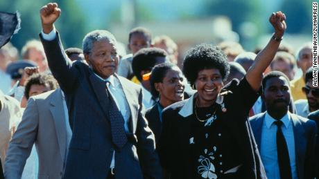 Nelson Mandela, with his then-wife, Winnie Mandela, leaves prison in 1990.