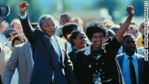 Nelson Mandela with his then-wife, Winnie Mandela, walk out of prison.