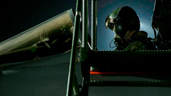 In this image released by Britain's Ministry of Defense, a Tornado pilot sits in his cockpit before flying at Britain Royal Air Force base in Akrotiri, Cyprus Saturday, April 14, 2018.