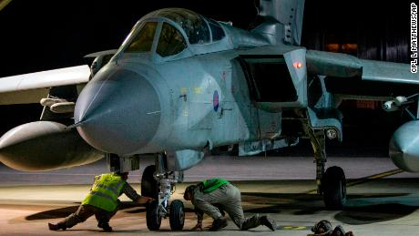 In this image released by Britain's Ministry of Defense, an RAF Tornado taxis into its hangar after landing at Britain Royal Air Force base in Akrotiri, Cyprus, after its mission to conduct strikes in support of operations over the Middle East Saturday, April 14, 2018. The United States, France and Britain launched military strikes in Syria to punish President Bashar Assad for an apparent chemical attack against civilians and to deter him from doing it again, President Donald Trump announced Friday. Pentagon officials said the attacks targeted the heart of Assad's programs to develop and produce chemical weapons. (Cpl L Matthews/MoD via AP)