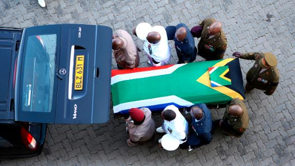 The flag-draped casket carrying Winnie Madikizela-Mandela's remains arrives Saturday, April 14, 2018, at Orlando Stadium in Johannesburg, South Africa.