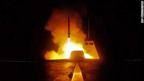 "TOPSHOT - A picture released by the French Defence audiovisual communication and production unit (ECPAD) shows the launching of a cruise missile from a French military vessel in the Mediterranean sea towards targets in Syria overnight April 13 to 14, 2018. The United States, France and Britain carried out a wave of punitive strikes against Bashar al-Assad's Syrian regime in the early hours of April 14, 2018 in response to alleged chemical weapons attacks. / AFP PHOTO / ECPAD AND AFP PHOTO / Handout / RESTRICTED TO EDITORIAL USE - MANDATORY CREDIT ""AFP PHOTO / ECPAD"" - NO MARKETING - NO ADVERTISING CAMPAIGNS - DISTRIBUTED AS A SERVICE TO CLIENTS- NO ARCHIVESHANDOUT/AFP/Getty Images"