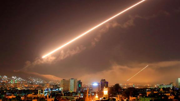 Damascus skies erupt with surface to air missile fire as the U.S. launches an attack on Syria targeting different parts of the Syrian capital Damascus, Syria, early Saturday, April 14, 2018. Syria