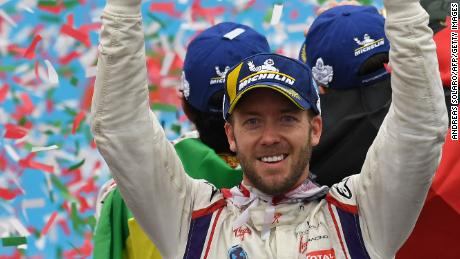 DS Virgin Racing driver Sam Bird celebrates on the podium after claiming victory in the inaugural Formula E race in Rome.