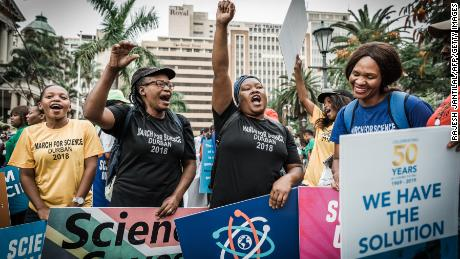 People holding banners shout slogans during the March for Science in Durban, South Africa, on April 14.