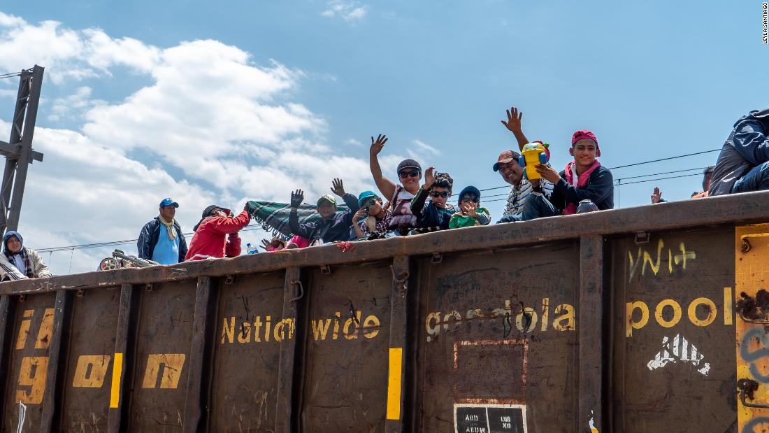 Caravan of migrants climbs freight train for the next leg of the journey